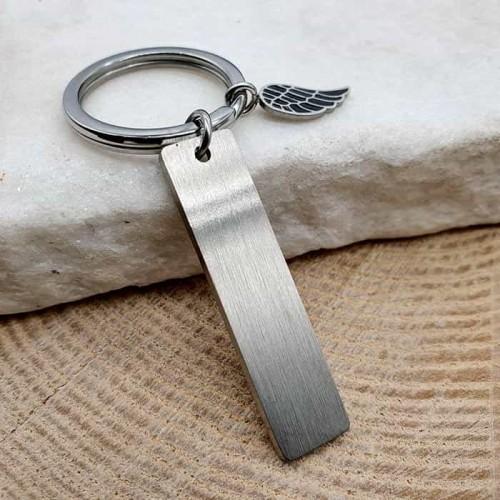Стальной брелок для ключей под гравировку с крылом матовый