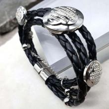 Черный браслет из натуральной плетеной кожи с декором из стали и фианитов