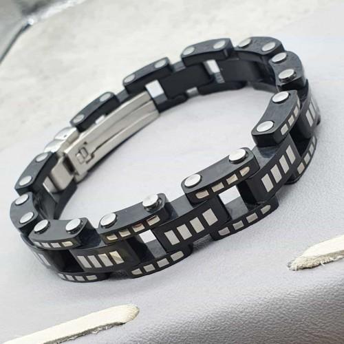 Черный браслет на руку со стальными элементами в виде велосипедной цепи