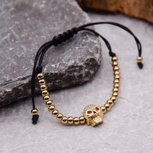 Женский браслет текстильный шнур Золотой череп