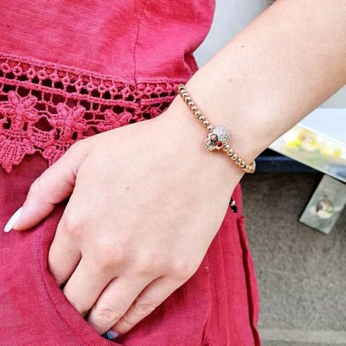 Браслет на затяжке из текстильного шнурка на руку Розовый череп