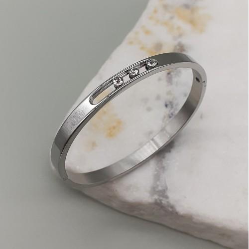 Браслет-обруч стальной с подвижными камнями Диамантика