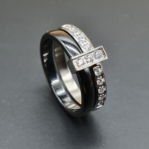 Кольцо из стали с черной керамикой и циркониями