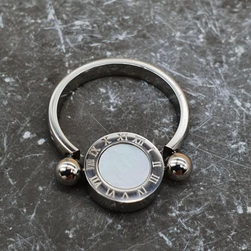 Женское стальное двухцветное кольцо с крутящимся элементом Адриатика