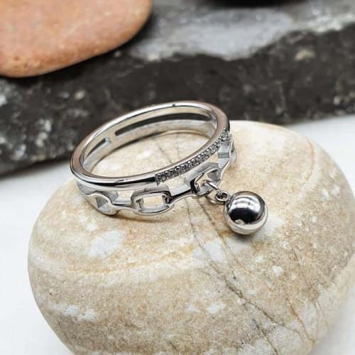 Женское кольцо из стали с подвеской-шариком и фианитами