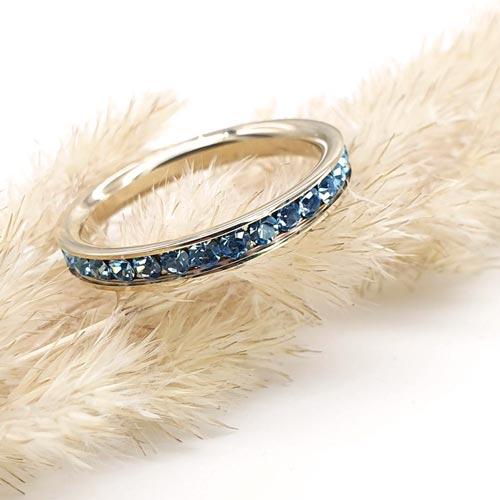 Женское стальное кольцо с циркониями цвета аквамарин